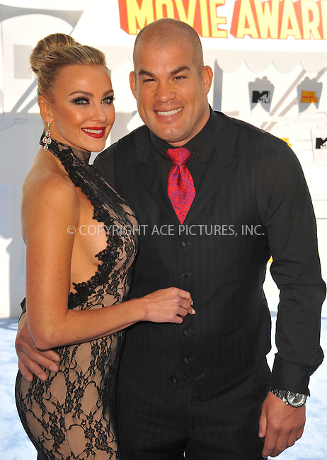 WWW.ACEPIXS.COM<br /> <br /> April 12 2015, LA<br /> <br /> Tito Ortiz and Amber Nicole Miller arriving at the 2015 MTV Movie Awards at the Nokia Theatre L.A. Live on April 12, 2015 in Los Angeles, California.<br /> <br /> By Line: Peter West/ACE Pictures<br /> <br /> <br /> ACE Pictures, Inc.<br /> tel: 646 769 0430<br /> Email: info@acepixs.com<br /> www.acepixs.com