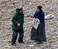 BNPS.co.uk (01202 558833)<br /> Pic: Graham Hunt/BNPS<br /> <br /> Light, Camera...Pastie time - Kate Winslet and director Francis Lee filming a scene on the Beach at Eype near Bridport in Dorset yesterday for the controversial new film Ammonite about the life of fossil hunter Mary Anning.