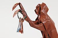 Origami Capuchin spider monkey with keys folded by Rosalind Joyce. Capuchin designed by Neal Elias. Keys designed by Christian Weinert.