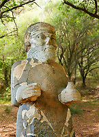 Pictures & images of the South Gate Hittite sculpture statue of Hittite Storm God Tarhunzas ( Tarḫunz Tarḫunna or in Hurrian Teshub or in Phoenician Baal Krntrys ). 8th century BC. Karatepe Aslantas Open-Air Museum (Karatepe-Aslantaş Açık Hava Müzesi), Osmaniye Province, Turkey.