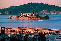 Alcatraz island, San Francisco Bay, Pier 45 foreground (closest point in San Francisco to Alcatraz), Angel Island behind Alcatraz (Pacific coast equivalent of Ellis Island). View from Russian Hill. San Francisco California USA.