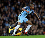 Fernando of Manchester City catches Alexis Sanchez of Arsenal during the English Premier League match at the Etihad Stadium, Manchester. Picture date: December 18th, 2016. Picture credit should read: Simon Bellis/Sportimage