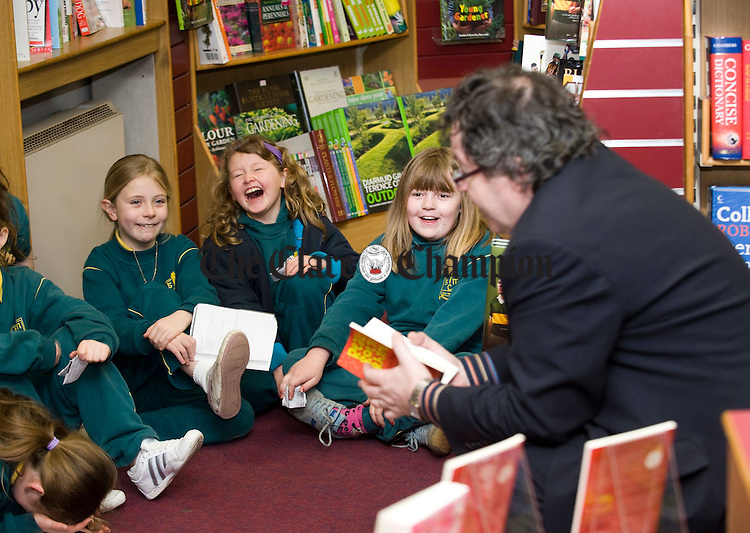 Gabriel Fitzmaurice, a childrens poet, entertaining pupils of Gaelscoil Mhichil Ciosog,  during a book reading at Ennis Bookshop as part of Seachtain na Gaeilge. Photograph by John Kelly.