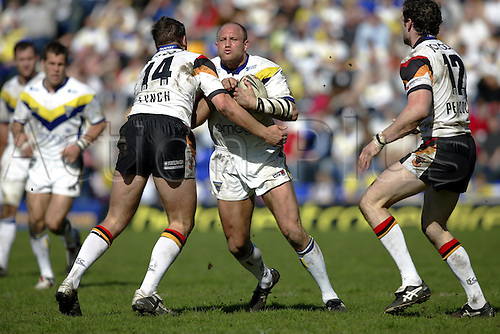 10 April 2005: Warrington front row Mark Hilton tackled by Andy Lynch during the Engage Super League match between Warrington Wolves and Bradford Bulls. Warrington won the game 35-32 played at the Halliwell Jones Stadium, Warrington. Photo: Neil Tingle/Action Plus...050410 player superleague