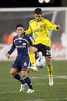 Ricardo Virtuoso (Columbus Crew, yellow) traps the ball as Jay Heaps (NE Revolution, blue) watches. NE Revolution defeat Columbus Crew, 1-0, at Gillette Stadium and secure home field advantage in the Eastern Conference Semifinal Series on October 14, 2006.