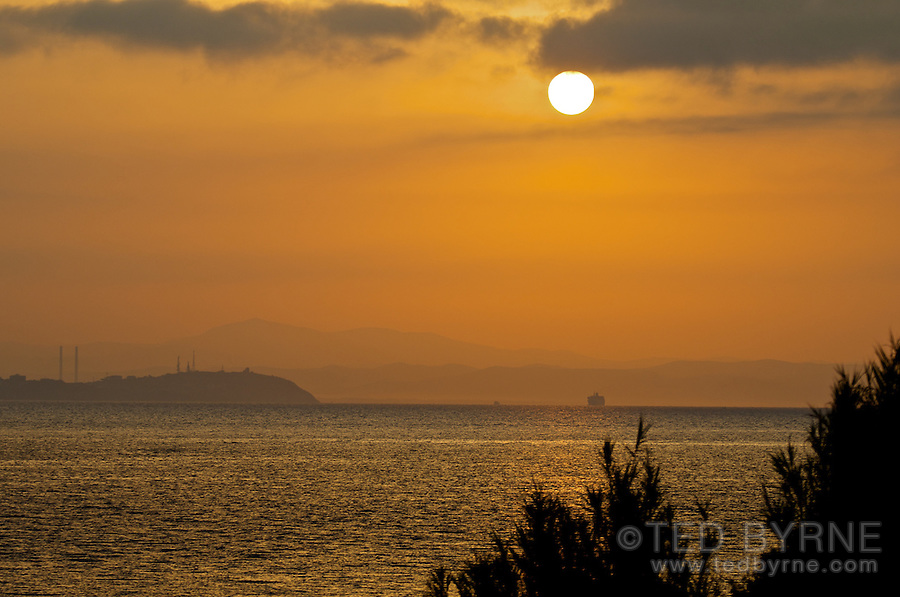 Ferry arriving in Piombino at sunrise