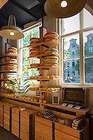 Traditional Gouda cheese wheels on sale in Dutch cheese shop in the Jordaan district of  Amsterdam, Holland