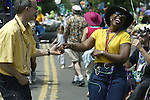 Lora Demans, right, swing dances with Scott Dungan while marching with the group Zydeco in the 21st annual Summer Solstice Parade held Saturday, June 20, 2009 in Seattle, Wa. The parade was held Saturday, bringing out painted and naked bicyclists, bands, belly dancers and floats. (Jim Bryant Photo © 2009). .