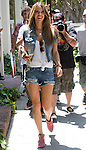 ..June 18th 2012 ...Alessandra Ambrosio wearing red boots shoes laughing & smiling with the Paparazzi on Melrose in Hollywood California. You couldn't even tell that Alessandra just had a baby a few weeks ago. Wearing short jean shorts & jacket carrying a snake skin purse ..AbilityFilms@yahoo.com.805-427-3519.www.AbilityFilms.com.