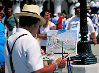 A painter captures the splendor of Venice, Italy. occupations, street scene, art, painting. Venice, Italy.
