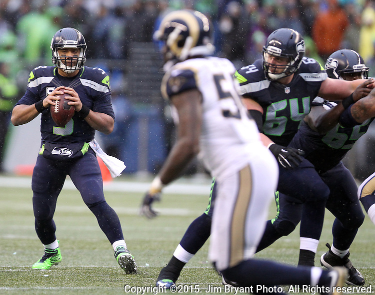 Seattle Seahawks quarterback Russell Wilson (3) looks to pass against the St. Louis Rams at CenturyLink Field in Seattle, Washington on December 27, 2015.  The Rams beat the Seahawks 23-17.      ©2015. Jim Bryant Photo. All Rights Reserved