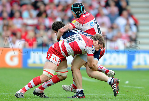 07.05.2011 Aviva Premiership Rugby from Kingsholm Stadium. Gloucester v Sale Sharks. Sale Sharks replacement (#18) Ben Roberts is tackled by Gloucester Flanker (#6) Alasdair Strokosch and replacement (#20) Brett Deacon in the second half.