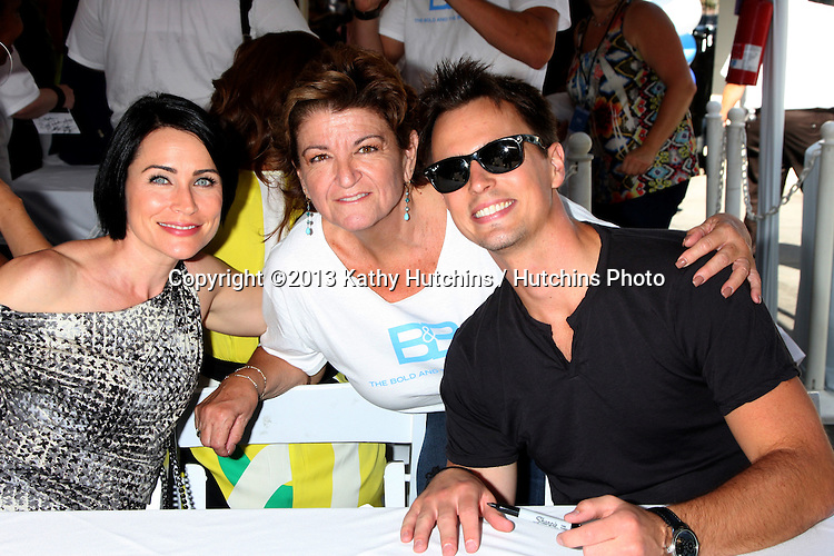 LOS ANGELES - AUG 23:  Rena Sofer, Toni Veltri, Darin Brooks at the Bold and Beautiful Fan Meet and Greet at the Farmers Market on August 23, 2013 in Los Angeles, CA