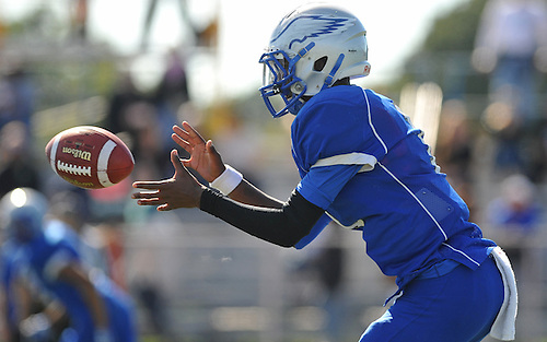 Ronald James, Jr., Copiague quarterback, takes a snap during the second quarter of a Suffolk County Division II varsity football game against Centereach at Copiague High School on Saturday, Sept. 24, 2016. Centereach won by a score of 26-0.