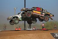 Apr 16, 2011; Surprise, AZ USA; LOORRS driver Greg Adler (10) jumps alongside Jeff Geiser (44) during round 3 at Speedworld Off Road Park. Mandatory Credit: Mark J. Rebilas-