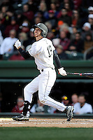 Center fielder Gene Cone (19) of the South Carolina Gamecocks bats in the Reedy River Rivalry game against the Clemson Tigers on Saturday, February 28, 2015, at Fluor Field at the West End in Greenville, South Carolina. South Carolina won, 4-1. (Tom Priddy/Four Seam Images)