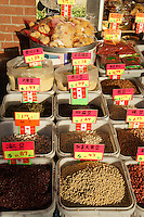 Bins of dried food in a store in Chinatown, Vancouver, British Columbia, Canada.