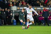 Kevin De Bruyne of Manchester City and Jordan Ayew of Swansea City during the EPL - Premier League match between Swansea City and Manchester City at the Liberty Stadium, Swansea, Wales on 13 December 2017. Photo by Mark  Hawkins / PRiME Media Images.