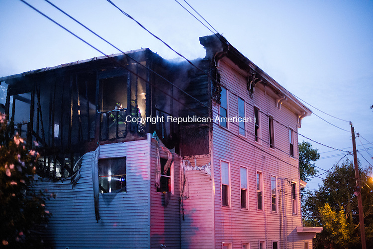 WATERBURY, CT- 21 August 2015-082115EC21-  Waterbury firefighters in the back of the house on the third floor at 684 Wilson Street Friday night. Erin Covey Republican-American