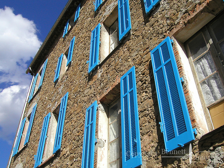 Blue shutters adorn this building in the villages of Collobrieres, in the Provence region of southern France.