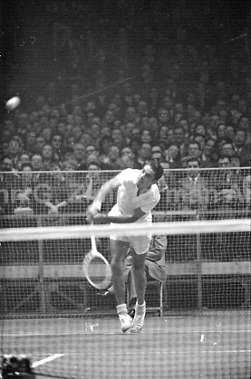 American professional tennis player Pancho Gonzales in action against Australian Lew Hoad, Madison Square Garden, 2/1958. Photograph by John G. Zimmerman.