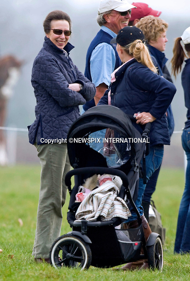 """ROYAL GRANDMOTHER PRINCESS ANNE (AND MARK PHILLIPS).watches over grandchild Savannah Phillips..Savannah who is son Peter Phillips and wife Autumn Kelly's first child was born in December 2010..She is the Queen's great grandaughter..They were at the Gatcombe Horse Trials, where daughter Zara Phillips was competing, Gatcombe_26/11/2011..Mandatory Credit Photo: ©Dias/NEWSPIX INTERNATIONAL..**ALL FEES PAYABLE TO: """"NEWSPIX INTERNATIONAL""""**..IMMEDIATE CONFIRMATION OF USAGE REQUIRED:.Newspix International, 31 Chinnery Hill, Bishop's Stortford, ENGLAND CM23 3PS.Tel:+441279 324672  ; Fax: +441279656877.Mobile:  07775681153.e-mail: info@newspixinternational.co.uk"""