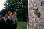 Quantock Staghounds 1990s Uk. Puppy show  Stag mounted trophy displayed on a cottage wall will be given as a prize 1997