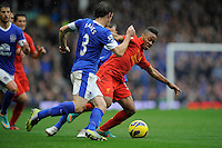 28.10.2012 Liverpool, England.Raheem Sterling of Liverpool and Leighton Baines  of Everton    in action during the Premier League game between Everton and Liverpool  from Goodison Park ,Liverpool