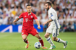 Thiago (L) of FC Bayern Munich fights for the ball with Daniel Carvajal Ramos (R) of Real Madrid during their 2016-17 UEFA Champions League Quarter-finals second leg match between Real Madrid and FC Bayern Munich at the Estadio Santiago Bernabeu on 18 April 2017 in Madrid, Spain. Photo by Diego Gonzalez Souto / Power Sport Images