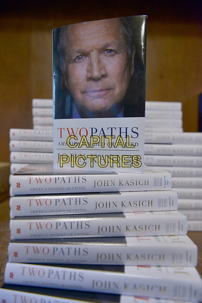 CORAL GABLES, FL - MAY 26: Atmosphere of book on display during John Kasich, Governor of Ohio and a former U.S. presidential candidate speaks and sign copies of his new book &quot;Two Paths: America Divided or United&quot; at Books and Books on May 26, 2017 in Coral Gables, Florida. <br /> CAP/MPI10<br /> &copy;MPI10/Capital Pictures