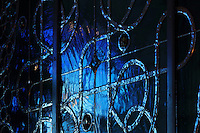 Detail of the stained glass window, with blue glass and leadwork in interlacing patterns reminiscent of the Neo-Romanesque style of the 19th century, made by Ateliers Loire, Chartres, in the Bell tower room themed 'Le Merveilleux' or The Supernatural, first floor, in Le Tresor de la Cathedral d'Angouleme, in Angouleme Cathedral, or the Cathedrale Saint-Pierre d'Angouleme, Angouleme, Charente, France. The 12th century Romanesque cathedral was largely reworked by Paul Abadie in 1852-75. In 2008, Jean-Michel Othoniel was commissioned by DRAC Aquitaine - Limousin - Poitou-Charentes to display the Treasure of the Cathedral in some of its rooms, which opened to the public on 30th September 2016. Picture by Manuel Cohen. L'autorisation de reproduire cette oeuvre doit etre demandee aupres de l'ADAGP/Permission to reproduce this work of art must be obtained from DACS.