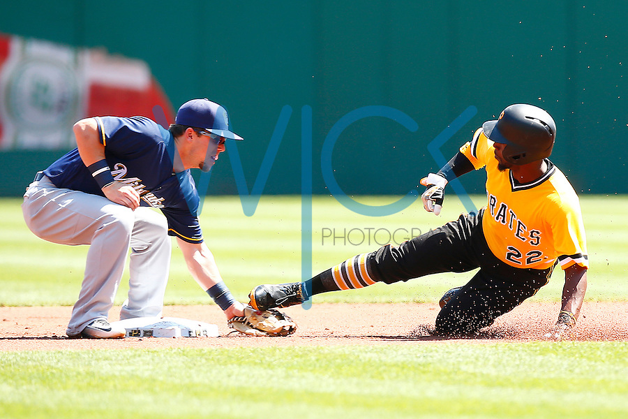 Andrew McCutchen #22 of the Pittsburgh Pirates is tagged out after attempting to steal second base by Aaron Hill #9 of the Milwaukee Brewers during the game at PNC Park in Pittsburgh, Pennsylvania on April 17, 2016. (Photo by Jared Wickerham / DKPS)