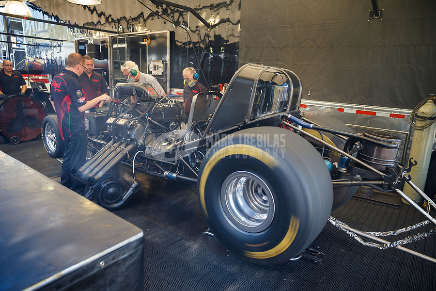 Jul 23, 2017; Morrison, CO, USA; NHRA funny car driver Jonnie Lindberg warms up his car in the pits during the Mile High Nationals at Bandimere Speedway. Mandatory Credit: Mark J. Rebilas-USA TODAY Sports