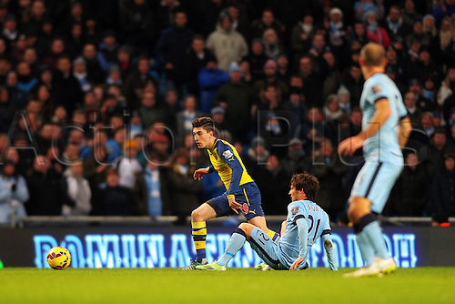 18.01.2015.  Manchester, England. Barclays Premier League. Manchester City versus Arsenal. Arsenal defender Hector Bellerin wins the ball frim Manchester City midfielder David Silva