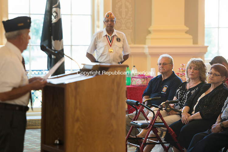 WATERBURY, CT - 26 August 2015-082615EC03-- Vincent DiDominzio, Jr. and his family listen as John Sarlo, the vice chairman of Waterbury Veterans Memorial Committee, talks about his father's  WWII medals Wednesday night at Waterbury City Hall. Vincent Didominzio Sr., posthumously received the Bronze Star, the Purple Heart, the Good Conduct Medal and the American Campaign Medal. The new medals were secured by Congresswoman Elizabeth Esty after the family reached out to the local V.F.W. post to help replace the missing ones. Erin Covey Republican-American.