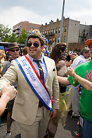 "Adam Richman of the Travel Channel's ""Man V. Food"" is this year's King Neptune during Coney Island's 2011 Mermaid Parade, a celebration of the sand, the sea, the salt air, and the beginning of summer, as well as the history and mythology of Coney Island, Coney Island pride, and artistic self-expression, held at Coney Island in Brooklyn, New York, 18 June 2011."