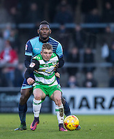 Aaron Pierre of Wycombe Wanderers & Ben Whitfield of Yeovil Town during the Sky Bet League 2 match between Wycombe Wanderers and Yeovil Town at Adams Park, High Wycombe, England on 14 January 2017. Photo by Andy Rowland / PRiME Media Images.