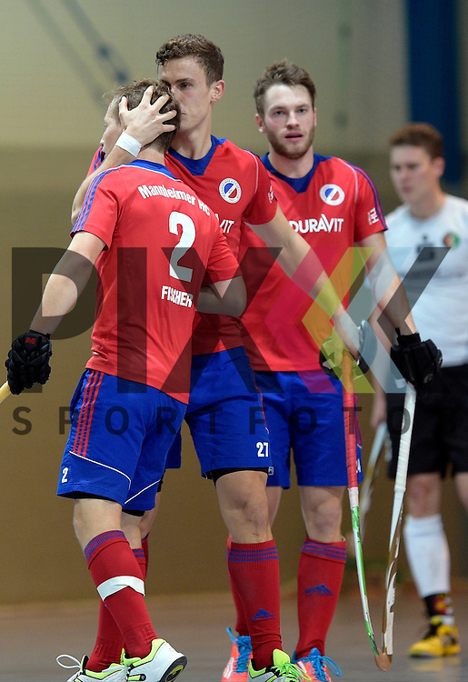 GER - Mannheim, Germany, November 28: During the 1. Bundesliga Sued Herren indoor hockey match between Mannheimer HC (red) and TG Frankenthal (white) on November 28, 2015 at Irma-Roechling-Halle in Mannheim, Germany. Final score 7-7 (HT 3-3).  (L-R) Jan Philipp Fischer #2 of Mannheimer HC, Timm Haase #27 of Mannheimer HC, Maximilian Neumann #24 of Mannheimer HC<br /> <br /> Foto &copy; PIX-Sportfotos *** Foto ist honorarpflichtig! *** Auf Anfrage in hoeherer Qualitaet/Aufloesung. Belegexemplar erbeten. Veroeffentlichung ausschliesslich fuer journalistisch-publizistische Zwecke. For editorial use only.