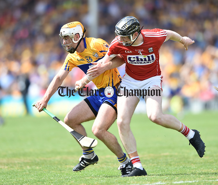 Conor Mc Grath of Clare in action against Damien Cahalane of Cork during their Munster senior hurling final at Thurles. Photograph by John Kelly.