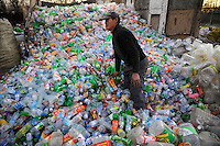 Recycling station at the northern outskirts of Beijing, a worker sorts out waste plastic material..20 Nov 2008