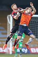 Oliver Lee of Luton Town (right) and Matt Harrold of Crawley Town (left) in an aerial battle during the Sky Bet League 2 match between Luton Town and Crawley Town at Kenilworth Road, Luton, England on 12 March 2016. Photo by David Horn/PRiME Media Images.