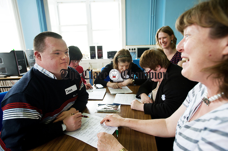 Sean Nestor, Mairead Hehir, Marie O Friel, Nadin Reichel, support worker, and Jill Hayes with Betty Murphy, teacher, in class at Latch On, a literacy programme for adults with Down Syndrome.