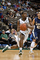 January 14, 2012:    Jacksonville Dolphins guard Chris Davis (11) drives toward the basket during Atlantic Sun conference action between the Jacksonville University Dolphins and East Tennessee State University Buccaneers at Veterans Memorial Arena in Jacksonville, Florida.   East Tennessee State defeated Jacksonville 72-58.