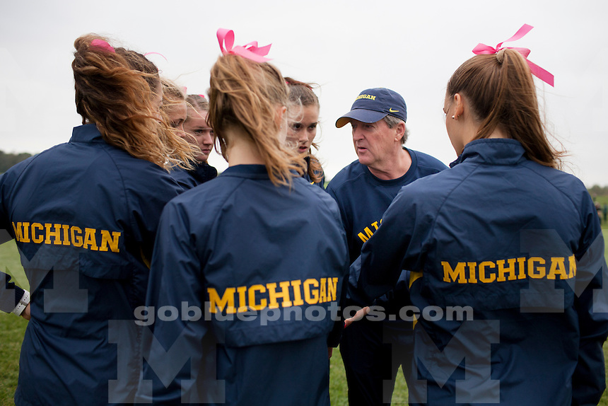 Michigan Women's Cross Country Head Coach Mike McGuire speaks to his runners before the Indiana State Pre-National Cross Country Invitational on Saturday, Oct. 15, 2016, in Terre Haute, Indiana. (Photo by James Brosher)