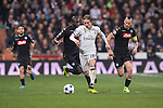 Luka Modric of Real Madrid fights for the ball with Marek Hamsik of SSC Napoli and his teammate Kalidou Koulibaly Real Madrid vs Napoli, part of the 2016-17 UEFA Champions League Round of 16 at the Santiago Bernabeu Stadium on 15 February 2017 in Madrid, Spain. Photo by Diego Gonzalez Souto / Power Sport Images