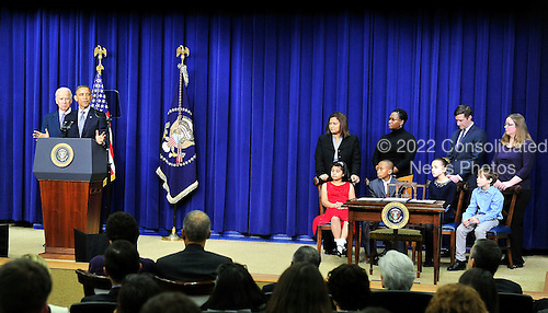 United States President Barack Obama makes remarks as Vice President Joe Biden listens at an event at the White House in Washington, D.C. to unveil a set of proposals to reduce gun violence on Wednesday, January 16, 2012..Credit: Ron Sachs / CNP