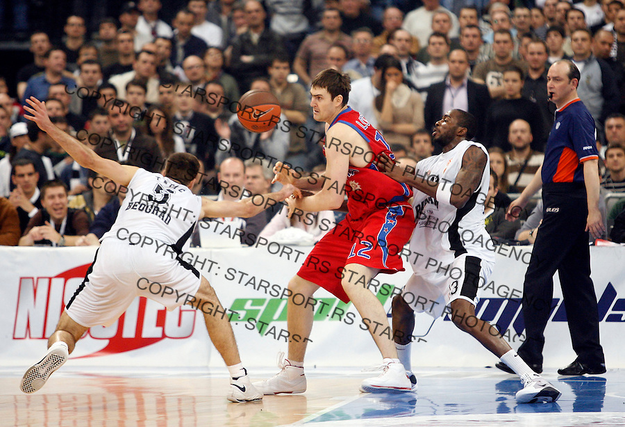 Kosarka, Euroleague, TOP 8, season 2008/09.Partizan Vs. CSKA Moscow, Game 3.Erazem Lorbek, center, Milenko Tepic, left and Stephane Lasme.Beograd, 31.03.2009..Photo: © Srdjan Stevanovic/Starsportphoto.com