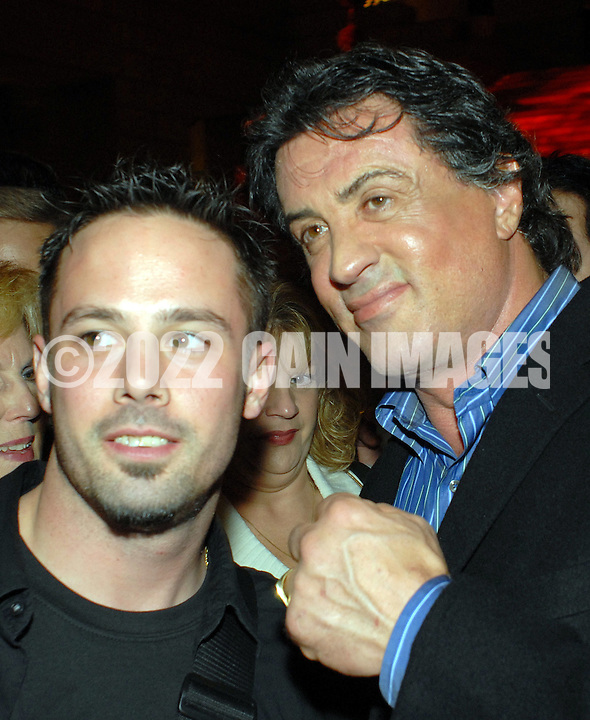 PHILADELPHIA - DECEMBER 18:  Sylvester Stallone (R) poses for photos with a fan at the afterparty for the Philadelphia premiere of Rocky Balboa at the Philadelphia Museum of Art December 18, 2006 in Philadelphia, Pennsylvania. Rocky Balboa opens December 20th. (Photo by William Thomas Cain/Getty Images for MGM)