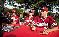 STANFORD, CA - April 23, 2011: A.J. Vanegas, Chris Reed and Chris Jenkins of Stanford baseball talks to a fan during an autograph signing after Stanford's game against UCLA at Sunken Diamond. Stanford won 5-4.