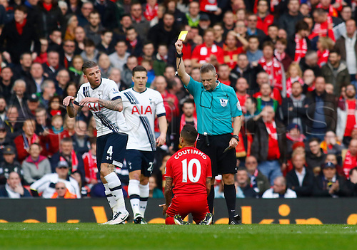 02.04.2016. Anfield, Liverpool, England. Barclays Premier League. Liverpool versus Tottenham Hotspur. Referee Jonathan Moss cautions Liverpool midfielder Philippe Coutinho for diving on the edge of the Spurs box.